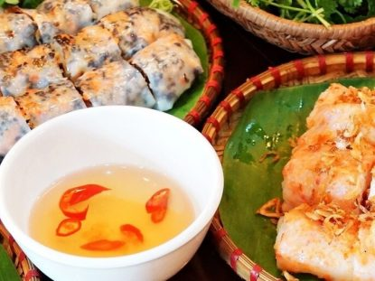 origin tracing back to Da Nang, Mi Quang is characterized by the yellow-colored rice noodles with a mixture of seasoned fish sauce, bone broth, shallot, garlic, black pepper